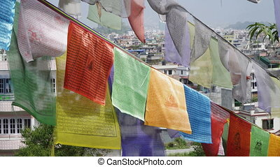Prayer flags on the background of Kathmandu houses