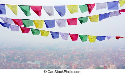 Buddhist prayer flags flying in the wind over Kathmandu, Nepal