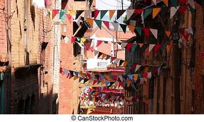 Prayer flags over streets of Kathmandu, Nepal - Buddhist...