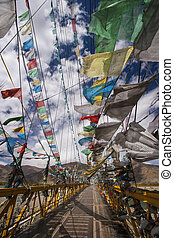 Prayer Flags - Tibet - China - Prayer flags on a footbridge...