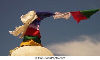 Prayer flags tied on Buddhists shrine, Himalayas - Extreme...