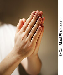 Hands clasped in a prayer.