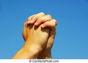 prayer hands - hands in prayer gesture on sky