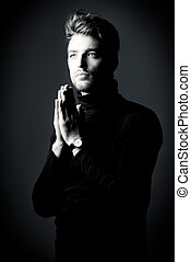 prayer man - Modern handsome young man in black pullover...