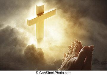 Prayer - Hands praying and cross in sky