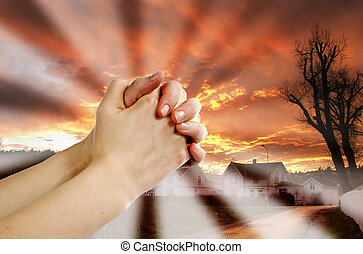 Prayer Warrior - Hands praying with a dramatic red sky overa...
