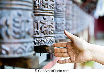 Prayer wheel in monastery, Nepal - Prayer wheels in...