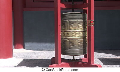 Prayer Wheel Spinning - Bronze prayer wheel spinning in the...