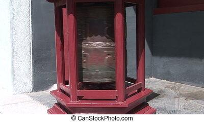Prayer Wheel Spinning - Bronze prayer wheel spinning in the...