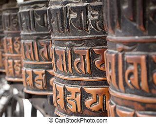 Prayer wheels - Decorated buddhist prayer wheels in a stupa....