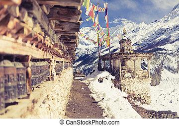 Prayer wheels in high Himalaya Mountains, Nepal village. ...