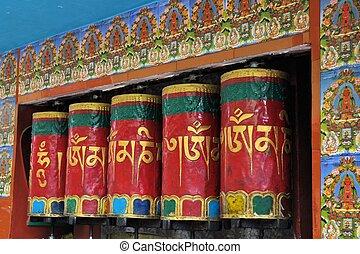 Mani Prayer wheels around a temple in center of town McLeod Ganj, Dharamsala, India