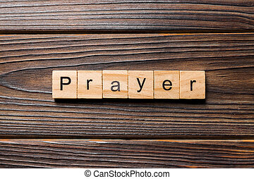 PRAYER word written on wood block. PRAYER text on wooden table for your desing, concept