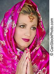 Prayerful India Woman - Woman posing in India attire in...