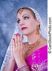 Prayerful India Woman - Model posing as woman in India...