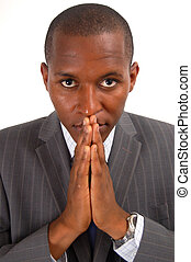 Prayerful Man - This is an image of a businessman, with a...