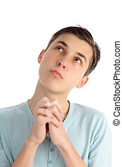 Prayerful thoughts and hopes - A boy praying and looking...