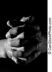 Praying - A closeup shot of praying old hands in black and...