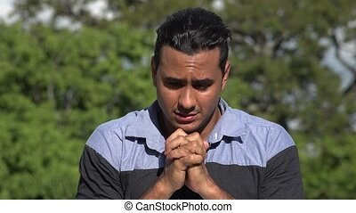 Praying Adult Hispanic Man