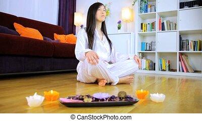 Praying and meditating - Beautiful Chinese woman meditating...