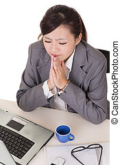 Praying business woman