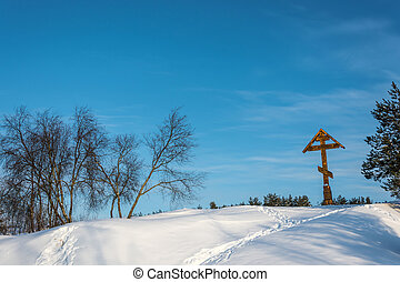 Praying cross on the Holy Irinarkhovo spring on a sunny...