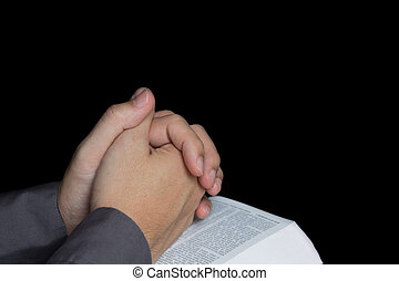 Praying hand with holy bible