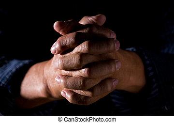 Praying hands - A shot of old man praying hands