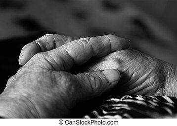 praying hands - hands in prayer of old woman in black and...