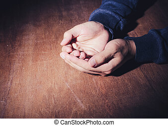 Praying Hands - The open praying hands on the wooden desk...