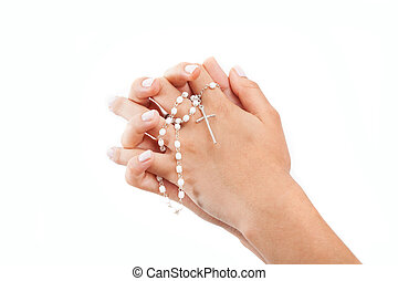Praying hands with a rosary