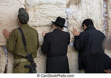 Praying jew - Jew prayers and soldier on Jerusalem Western...