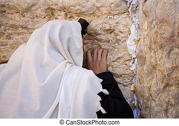 Praying Jew on Jerusalem Western wall during sabbath.