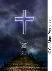 Praying man before a cross