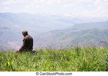 Praying man kneeling rear view - Senior man kneeling while...