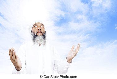 Praying man - Stock image of Arabic man praying over open...