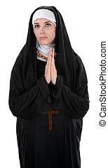 Praying Nun - Innocent nun with palms together in prayer