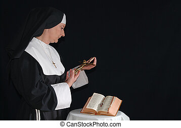 Praying nun - Middle aged devout nun in deep thoughts,...