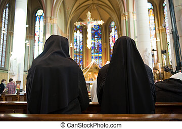 Praying nuns