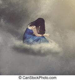 Woman praying alone while sitting on a cloud.