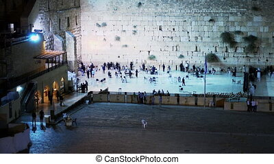 Praying people next to Western Wall
