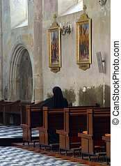 Praying sister inside church