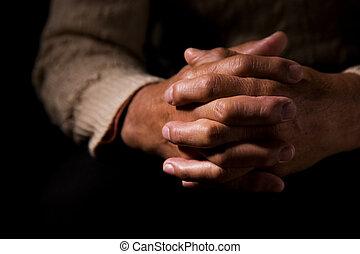Praying - A shot of hands of an old man praying