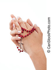 Praying with rosary, isolated - Praying hands with rosary on...
