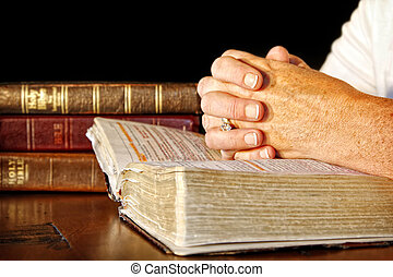 Praying Woman With Holy Bibles