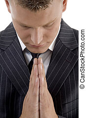 praying young businessman