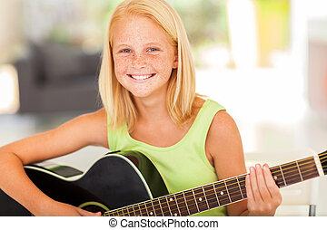 pre, adolescente niña, practicar, guitarra, en casa