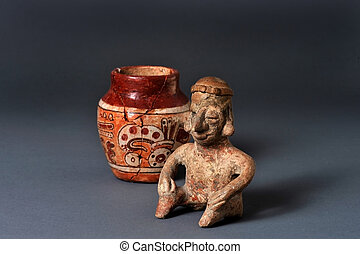 Pre-Columbian Art - Mayan seated man and painted jar.