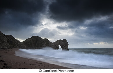 Pre-dawn Durdle Door on Jurassic Coast in England - Stormy...