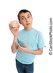 Pre teen boy rattling a money box